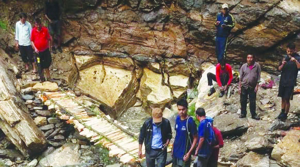 A log bridge in rain affected area in Pithoragarh.