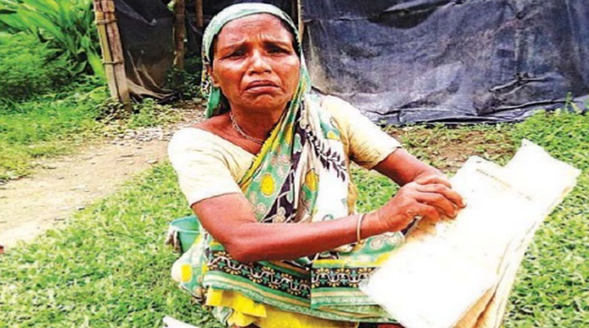 Worried after failing to find her name in the NRC draft, Runubala Sarkar, 59, shows her documents in Srirampur Village in Kokrajhar district, Assam, on Wednesday. (Photo: SNS)