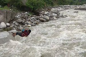 Teacher does a 'Tarzan' to reach school cut off due to rains in Uttarakhand