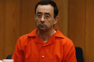 Ex-coach booked on charges related to US gymnastics sex scandal