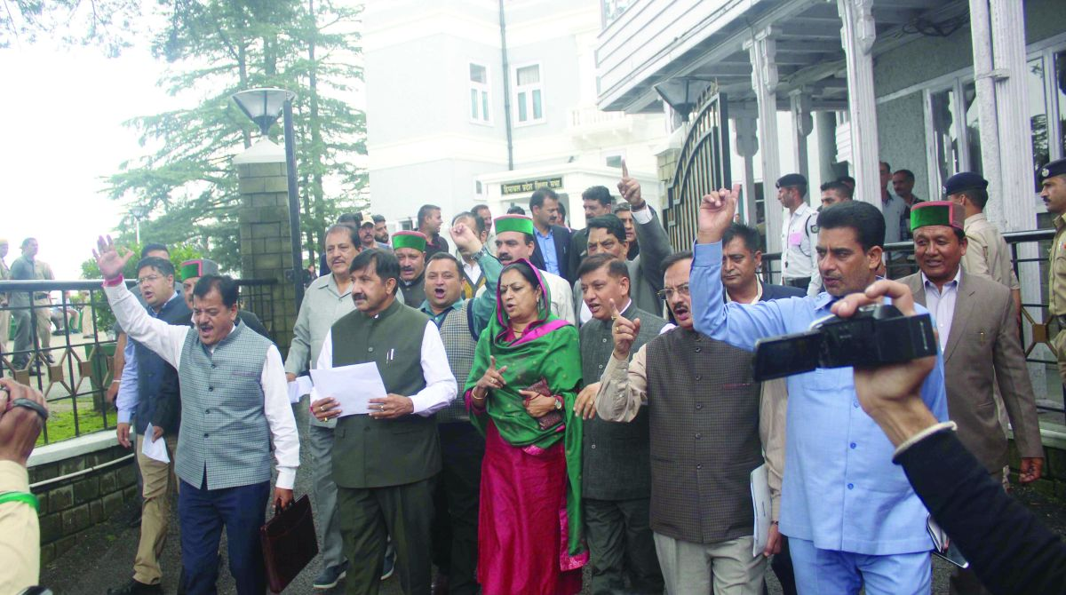Leader of opposition Mukesh Agnihotri and other Congress MLAs walking out of the Assembly in Shimla on Friday. (Photo: Lalit Kumar)