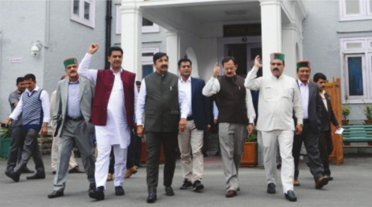 Leader of opposition Mukesh Agnihotri with other Congress MLAs stage after walking out from state Assembly in Shimla on Thursday. (Photo: SNS)
