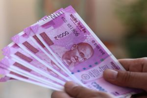 Rupee devalues to record low near 70.20