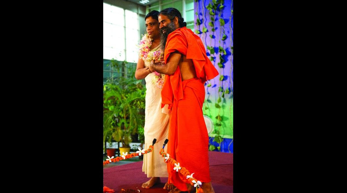 Baba Ramdev greeting his close aide Acharya Balkrishna on his birthday in Haridwar on Saturday. (Photo: SNS)