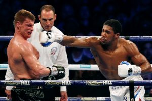 Anthony Joshua overpowers Alexander Povetkin to retain world heavyweight titles
