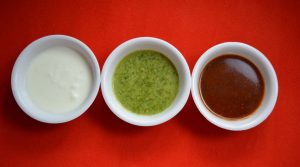 Coriander chutney and tamarind chutney with curd