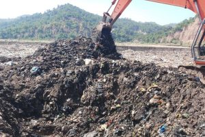 Dumping of solid waste from town in village makes locals fume