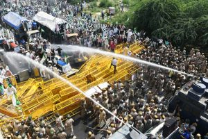 Police use tear gas, water cannons to stop farmer protest march to Delhi