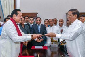 Mahinda Rajapaksa vows to set up interim govt to protect human rights
