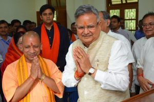 Chhattisgarh CM Raman Singh touches feet of Yogi Adityanath after filing nomination