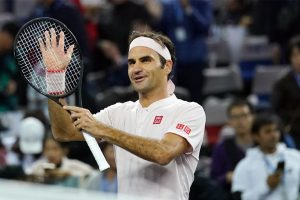 Shanghai Masters: Roger Federer does family proud to battle into quarters