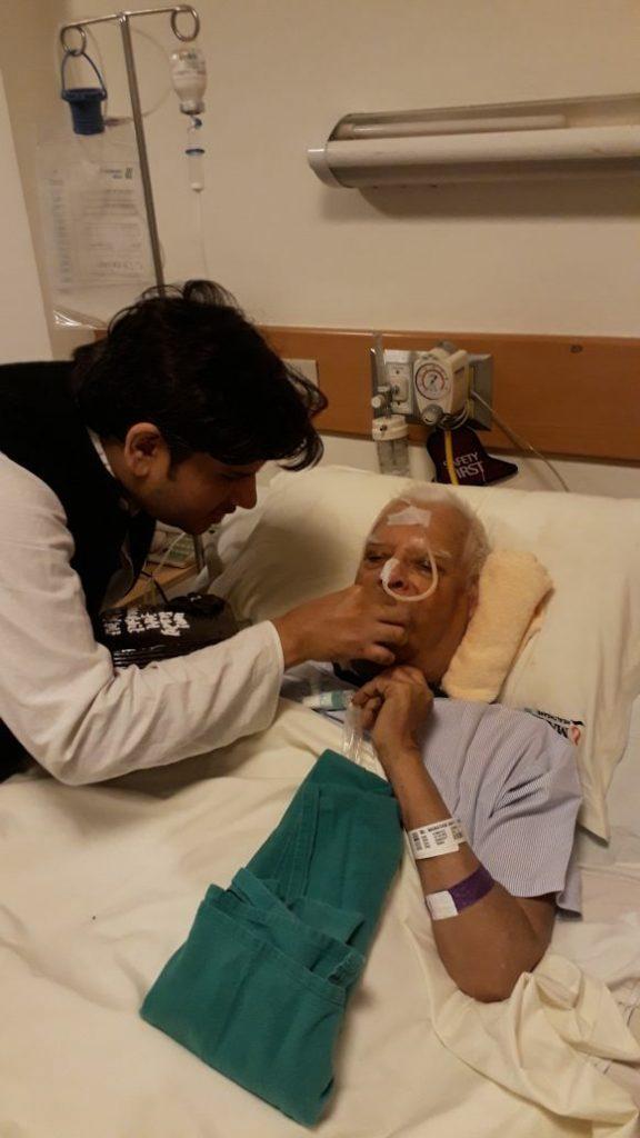 Son Rohit Shekhar feeding ND Tiwari at a hospital.