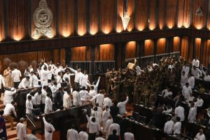 Chaos prevails in Lankan Parliament as leaders hurl chilli power, furniture