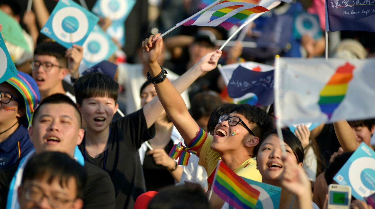 People take part in a rally in support of same-sex marriage near the  Presidential Office in Taipei on November 18, 2018, ahead of a landmark  vote on LGBT ...