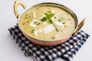Creamy white gravy sweet and tangy paneer