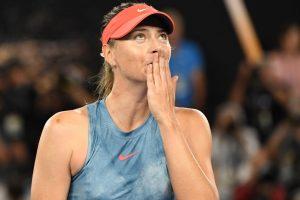 Sharapova defeats defending Australian Open champion Wozniacki