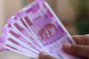 Rupee opens marginally higher post RBI policy decision