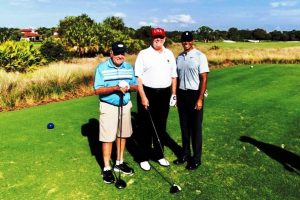 Donald Trump plays golf with Tiger Woods at Trump National Golf Club