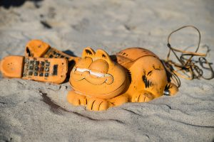 Mystery of Garfield telephones washing up on French beach solved after 30 years