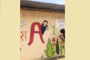Oxford University Press employees paint a slum school on occasion of 'World Art Day'