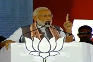 PM Modi slams Sharad Pawar for latter's remark on his family