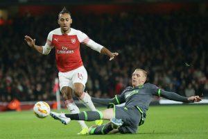 Arsenal edge past 10-man Watford, move into top four