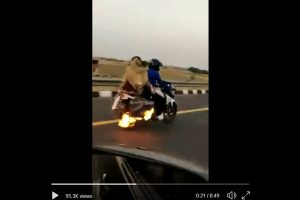 WATCH | UP policemen chase down bike on fire, save three lives