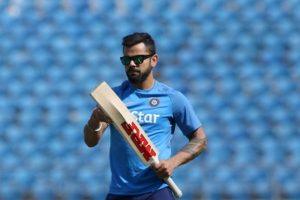 Virat Kohli steps in with ball at nets