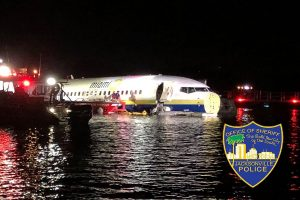 Boeing 737 with 143 on board slides off runway, falls into river in US; 21 injured