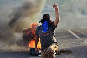 Hondurans demand president resigns in protests amid strikes