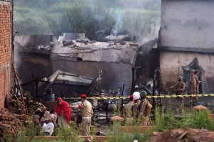 17 including 5 crew members killed as Pakistani army plane crashes into residential area
