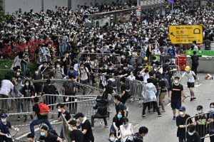 Thousands of protesters in Hong Kong defy police ban, begin march