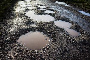 Raiganj locals block highway over bad road