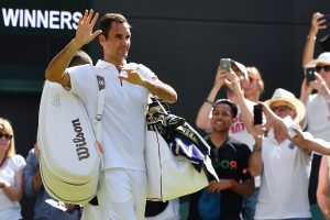 Federer advances to Wimbledon third round