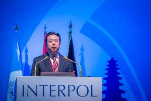 Wife of ex-Chinese Interpol chief sues agency