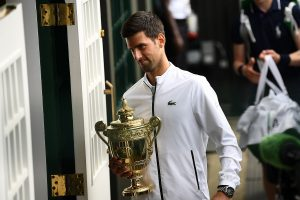 Djokovic saves match points to claim fifth Wimbledon title in record-breaking final