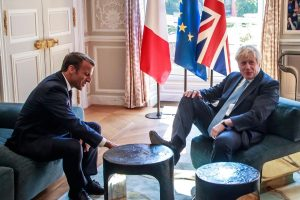 With foot on table, Boris speaks on Brexit deal with French President Macron