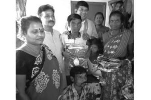 BJP gifts puja clothes for Naxalbari family