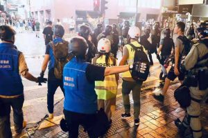 Hong Kong police fire tear gas at protesters in shopping district