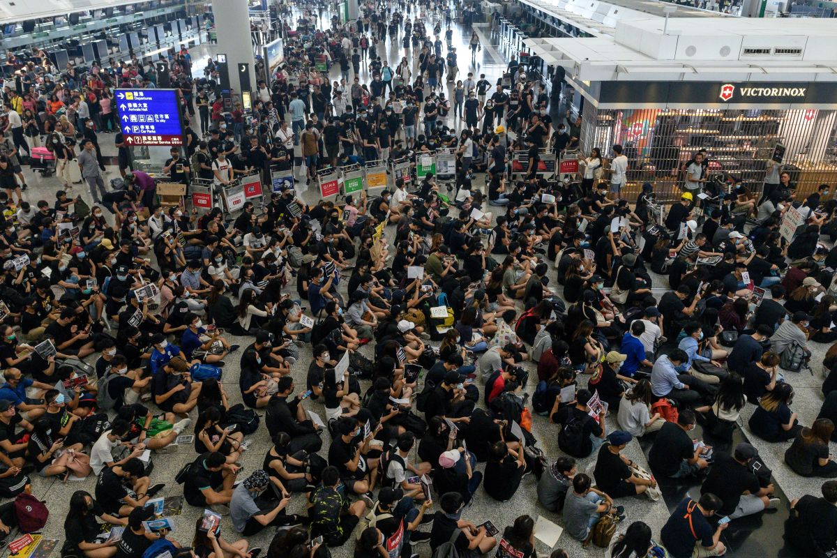 Hong Kong leader tells United States not to 'interfere' after fresh protests
