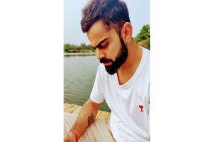Virat Kohli flaunts Anushka's initials on white t-shirt