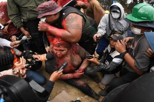 Mayor of Bolivian town dragged through streets, covered in paint by protesters