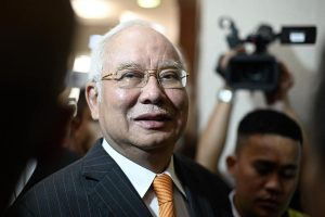 Former Malaysia PM to defend himself in corruption charges in 1MDB trial