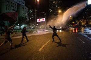 Chile proposes aid for poor households as protests continue