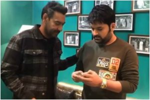 Watch | Ajay Devgn bribes Kapil Sharma to promote 'Tanhaji'
