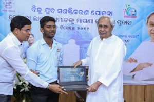 Naveen Patnaik distributes free laptops to meritorious students in Odisha