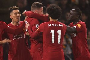 Henderson, Firmino score as Liverpool beat Wolves 2-1 for 14th straight Premier League win