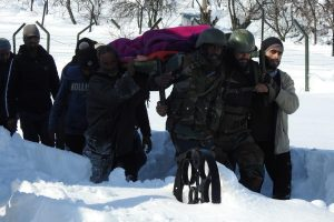 Army soldiers in Kashmir carry pregnant woman to hospital in waist-deep snow