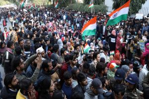 Massive protest erupts near Jamia after man opens fire, police barricades to block march to Rajghat