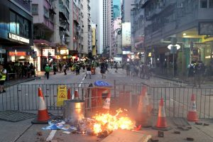 Tear gas fired as HK protesters block roads